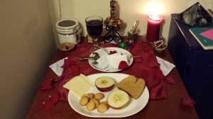 Everything lit; a quick execration above the petitions; and a feast fit for a goddess.